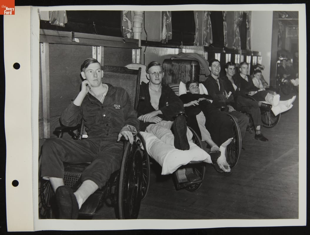 Row of men in wheelchairs