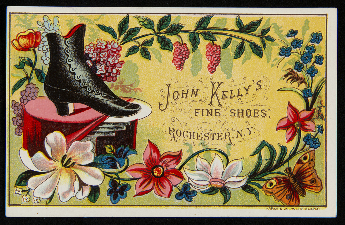 Yellow card with drawing of black lace-up shoe and flowers around edge of card; text in middle