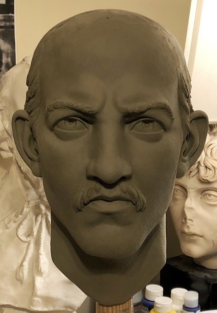 Head of man with receding hairline, mustache