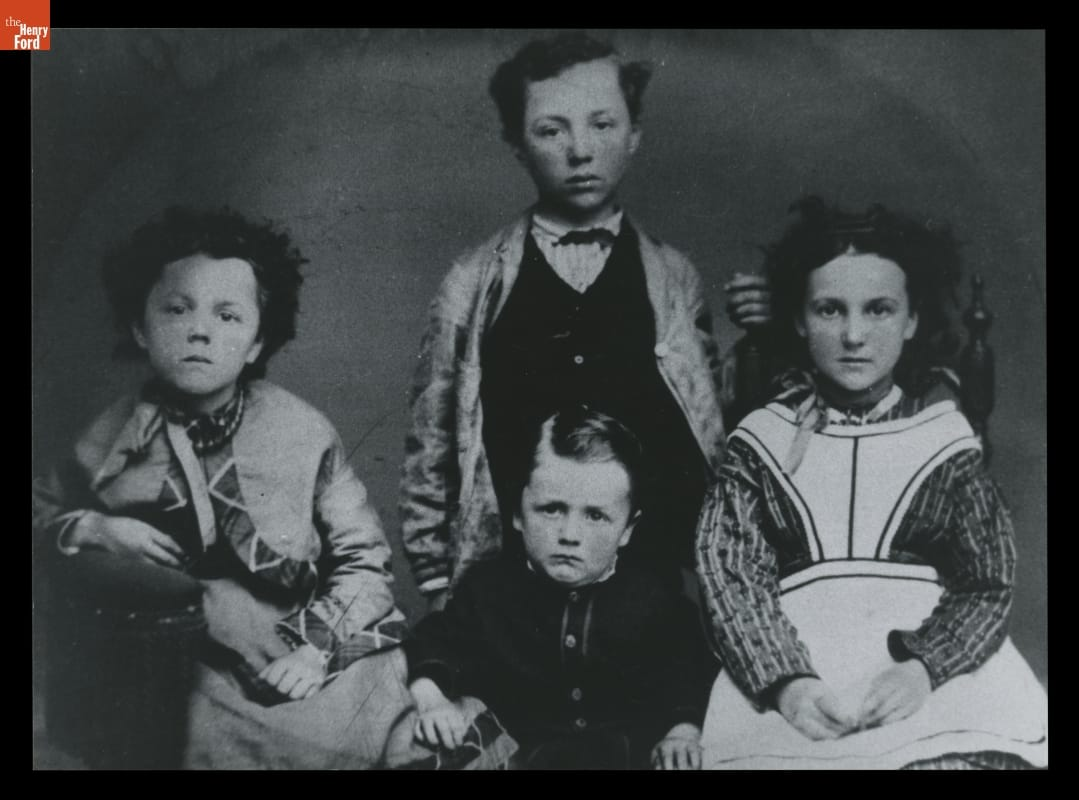 Four children with glum expressions