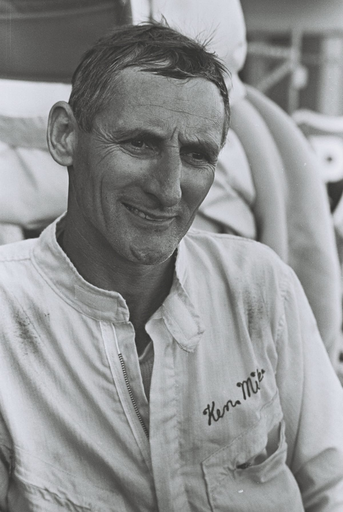 Black-and-white photo of smiling man
