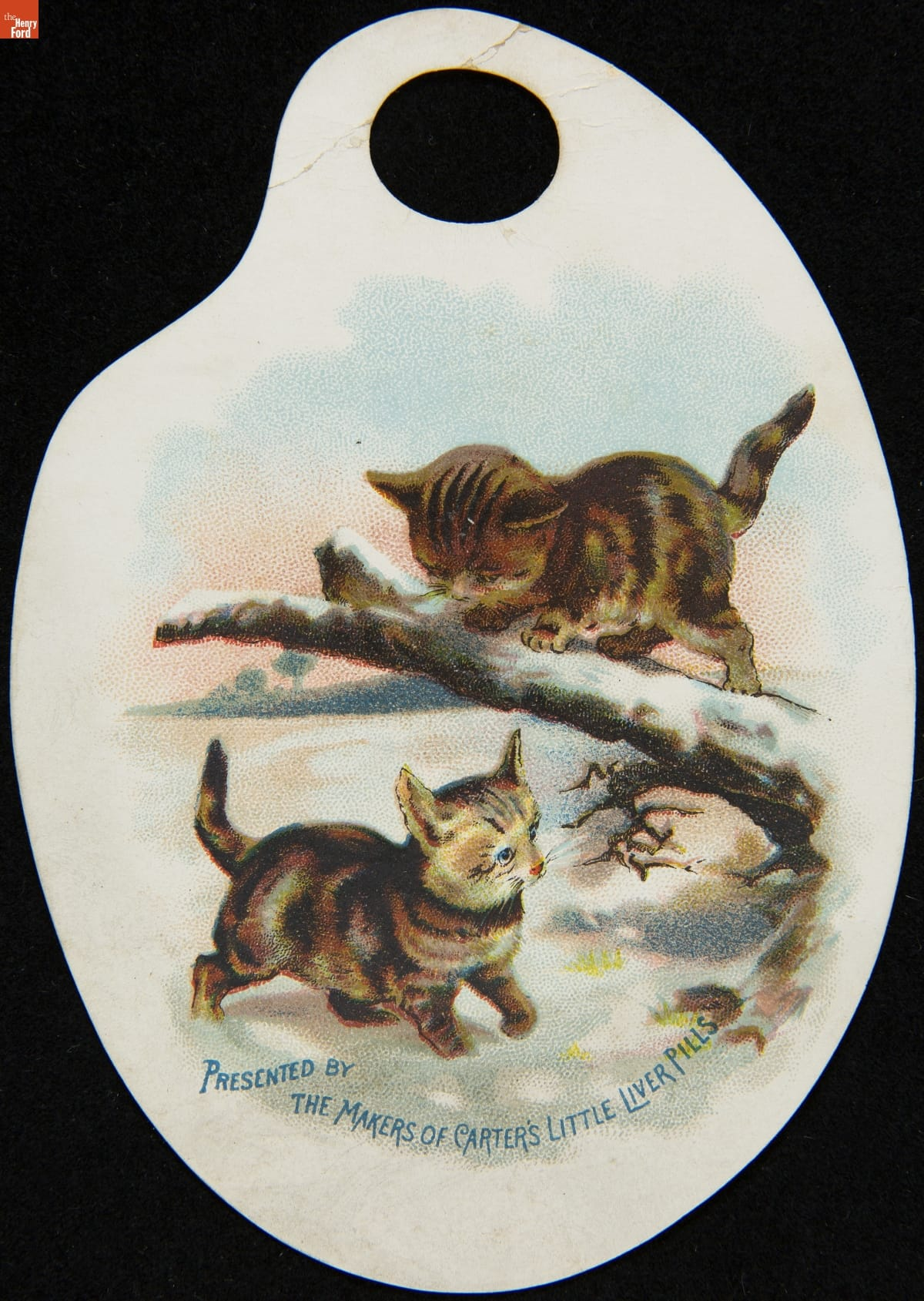Palette-shaped paper containing illustrations of two kittens cavorting in snow