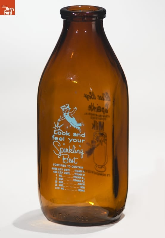 Brown bottle with blue text and image of boy in overalls with Peter Pan-type hat