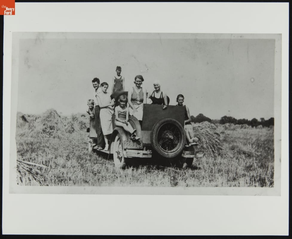 Group of about seven people in and on a truck