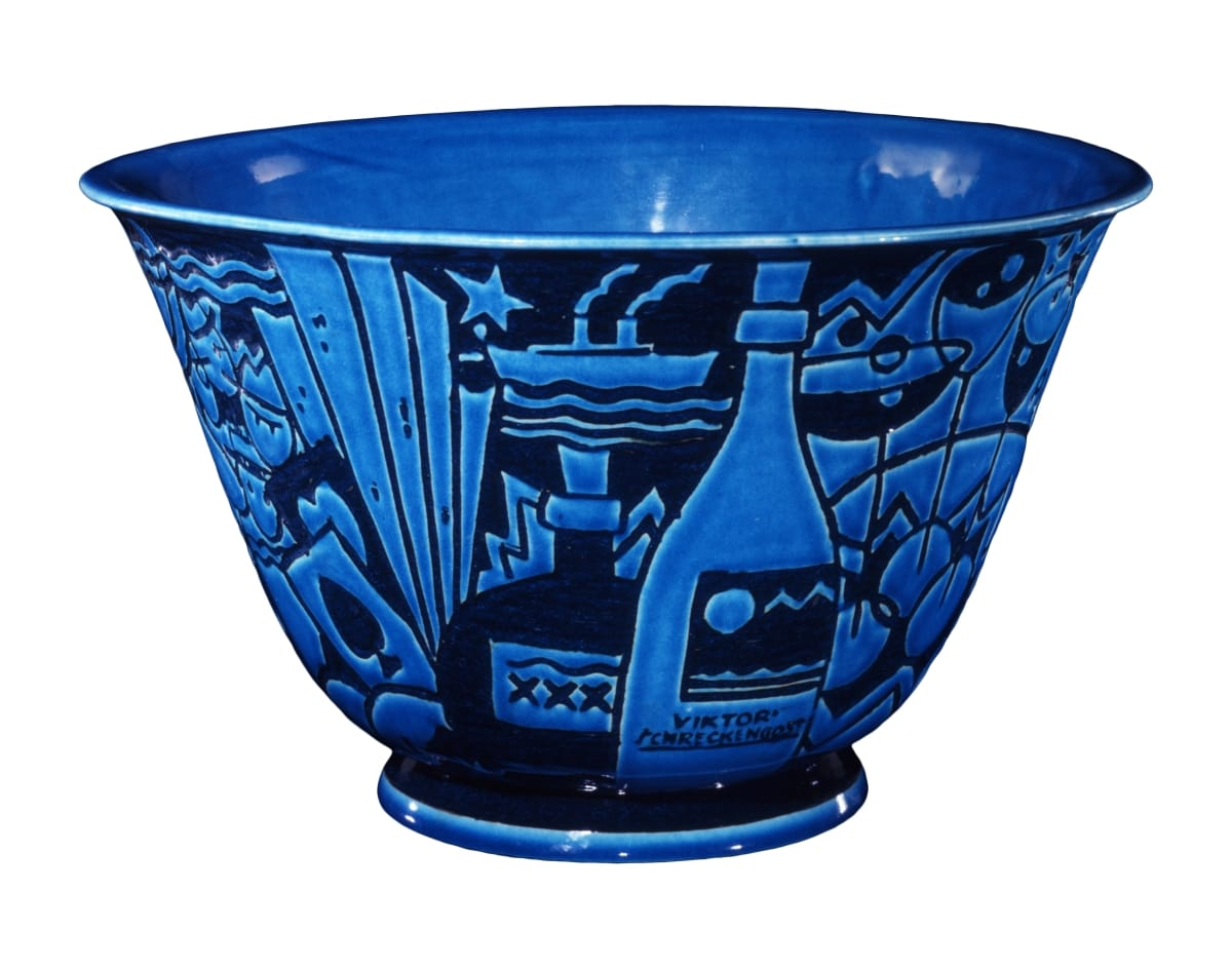 Bowl in two shades of blue depicting a champagne bottle and ship, among other decorative elements