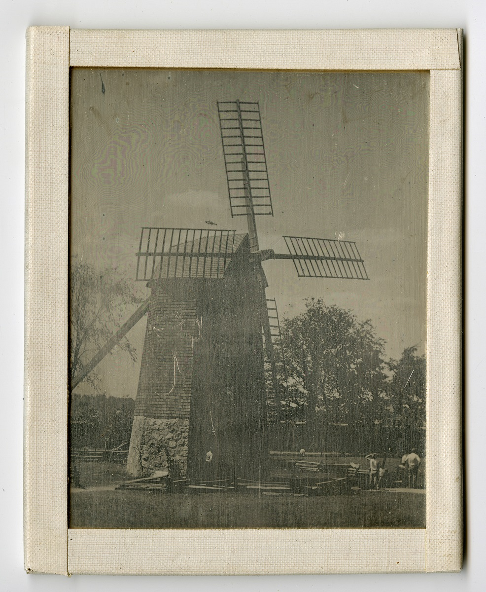Black-and-white image of windmill in frame