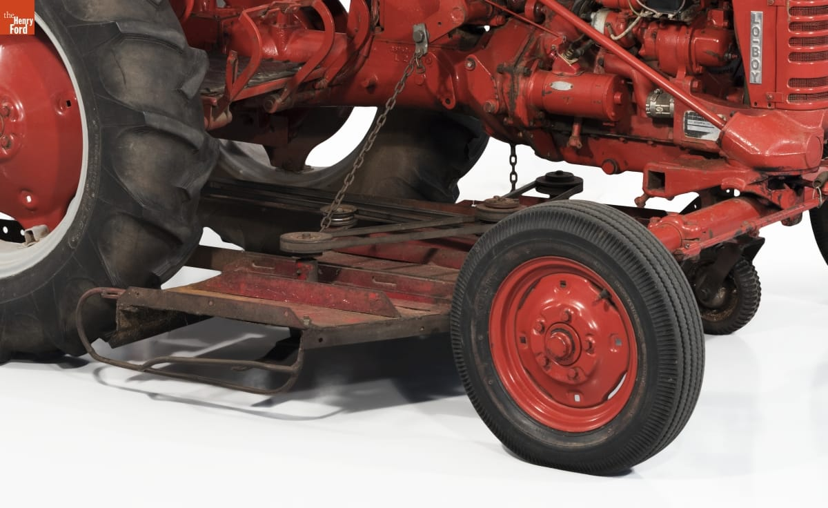 Close-up of red metal plate mounted beneath red tractor