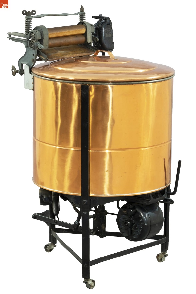 Machine on stand with large copper tub and motor below