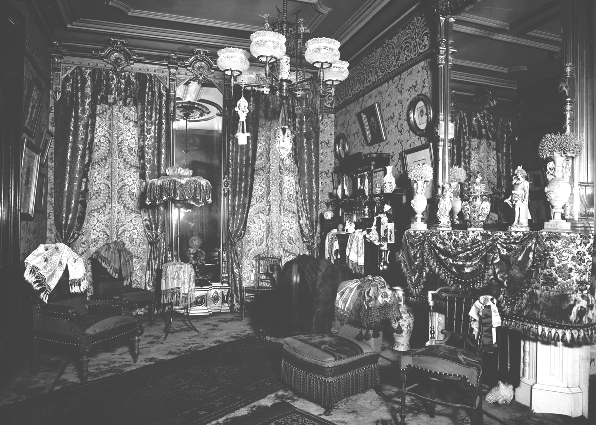 Room crowded with furnishings and drapery