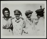 Four women, some wearing motoring coats and hats